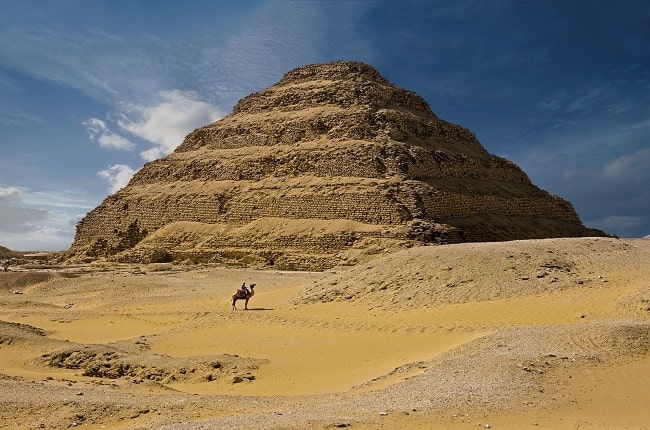 How was the first pyramid in history built?